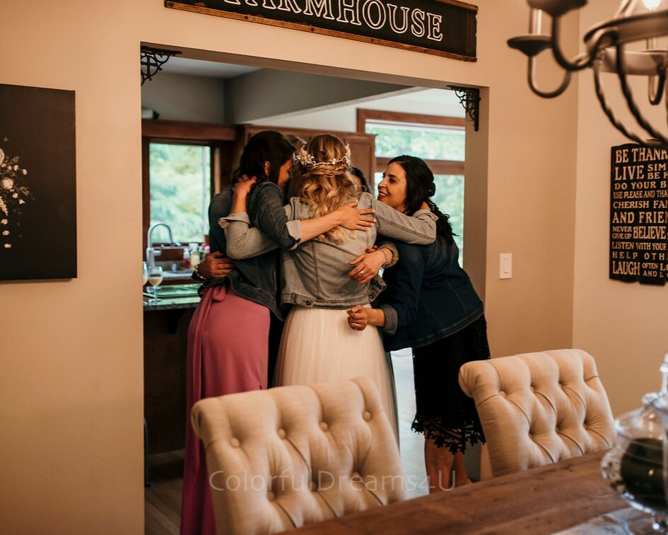 Bride hugging her bridesmaids before walking down the aisle at her June backyard intimate summer wedding in Hubertus Wisconsin - Planned by Natural Elegance LLC - Photo by Colorful Dreams 4U.png