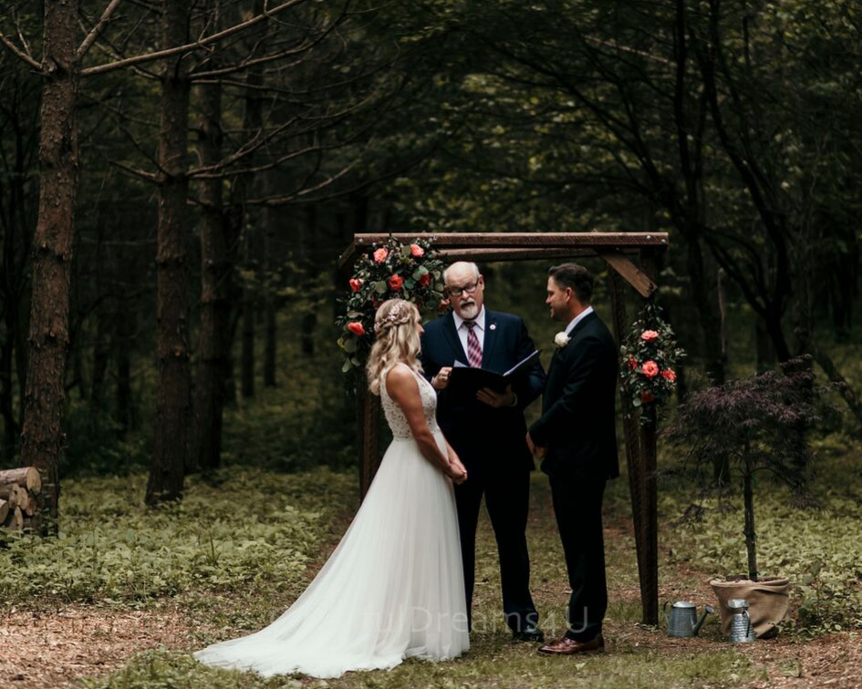Bride and groom at their intimated wedding ceremony in the woods - June backyard summer wedding in Hubertus Wisconsin - Planned by Natural Elegance LLC - Photo by Colorful Dreams 4U.png