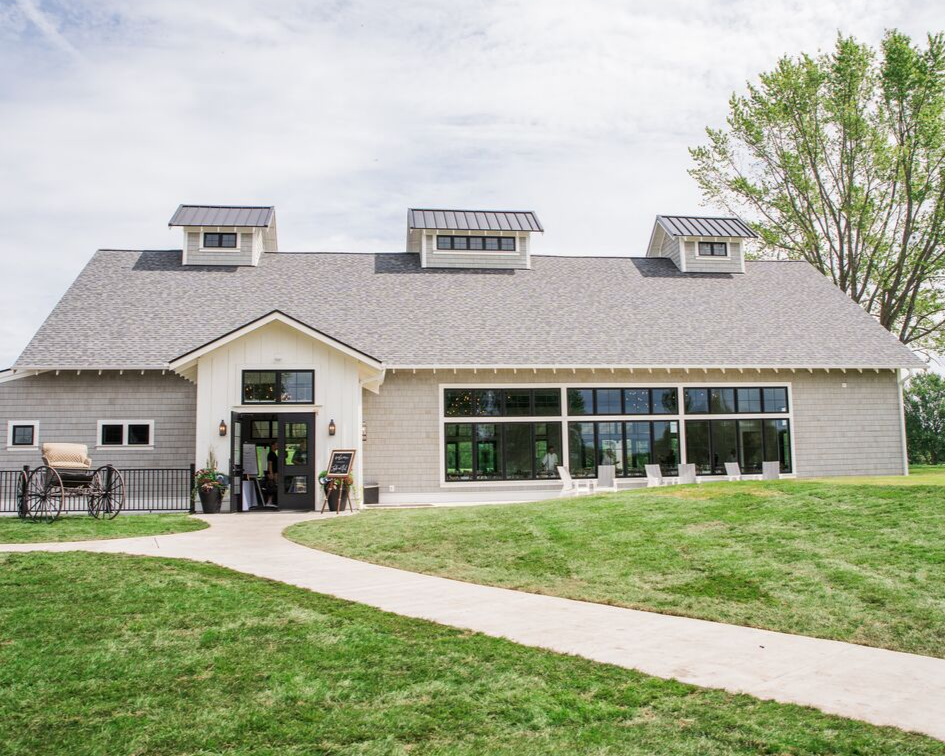 1 lake country wedding at the carriage house at lac labelle in oconomowoc wisconsin - planned by natural elegance llc - photo by spottswood photography - outside view of the carriage house.png