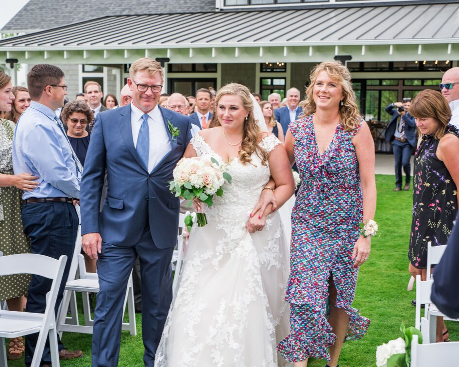 10 lake country wedding at the carriage house at lac labelle in oconomowoc wisconsin - planned by natural elegance llc - photo by spottswood photography - father and mother of the bride walking her down the aisle.png