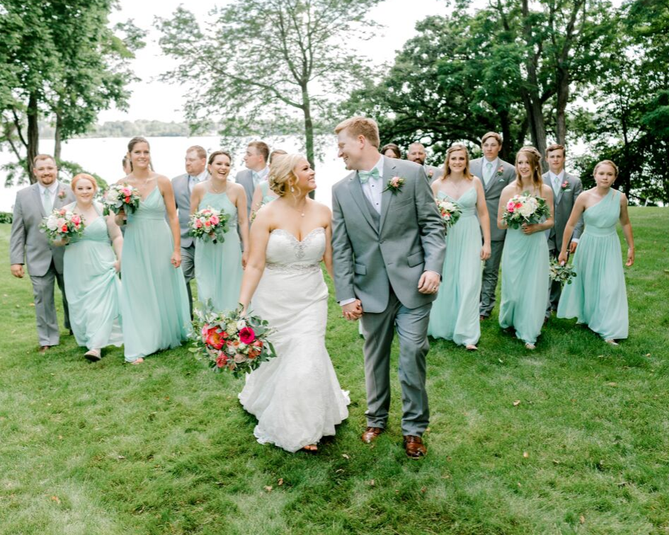 bride and groom with their wedding party from a lake club wedding at the Oconomowoc Lake Club in Wisconsin - Wedding planned by Natural Elegance LLC and Photo by Faith Photography.png