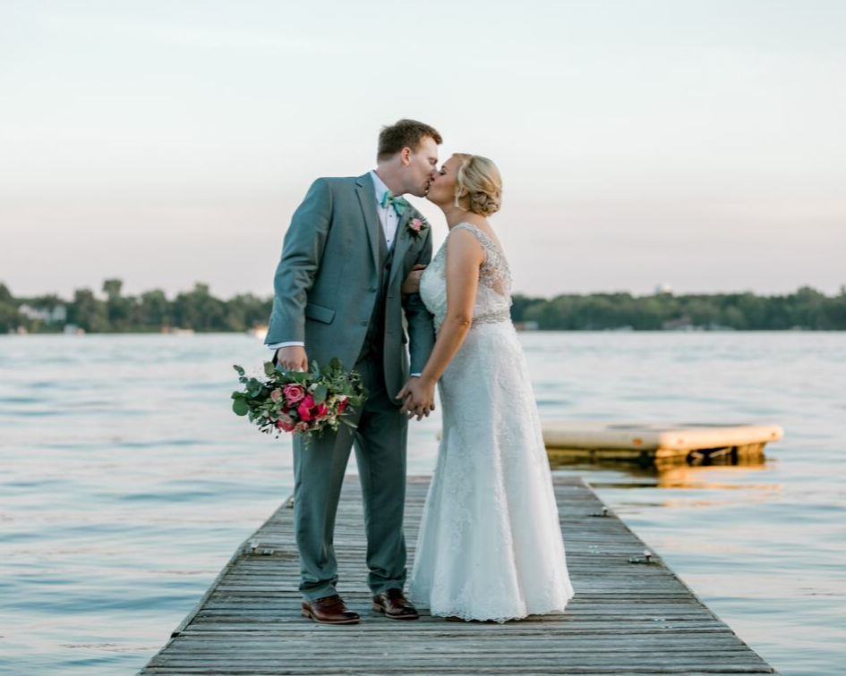 bride and groom on the dock from a lake club wedding at the Oconomowoc Lake Club in Wisconsin - Wedding planned by Natural Elegance LLC and Photo by Faith Photography.png