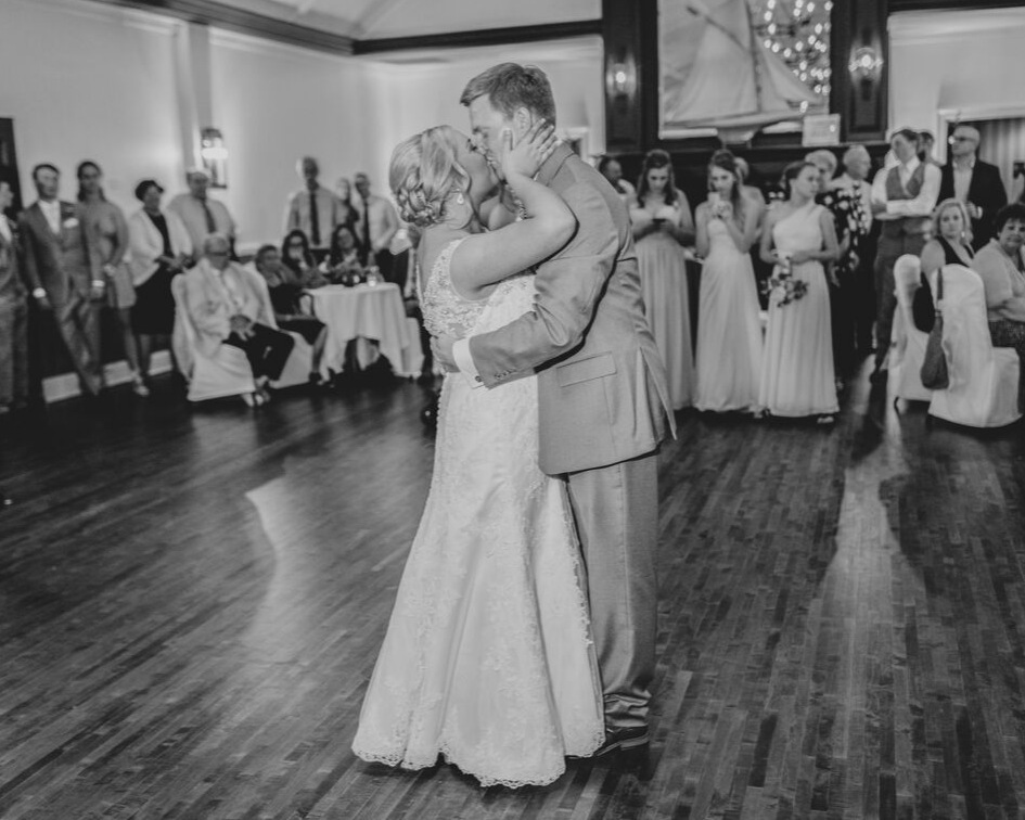 bride and groom first dance from a lake club wedding at the Oconomowoc Lake Club in Wisconsin - Wedding planned by Natural Elegance LLC and Photo by Faith Photography.png