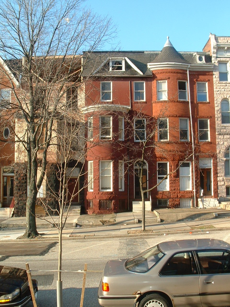 - SP Arch Inc. was hired renovate two large row homes into six condo apartments. Design included restoration of the interior and exterior brick walls, doors and windows. The unique historic front façade details were preserved, not revealing the contemporary interior.