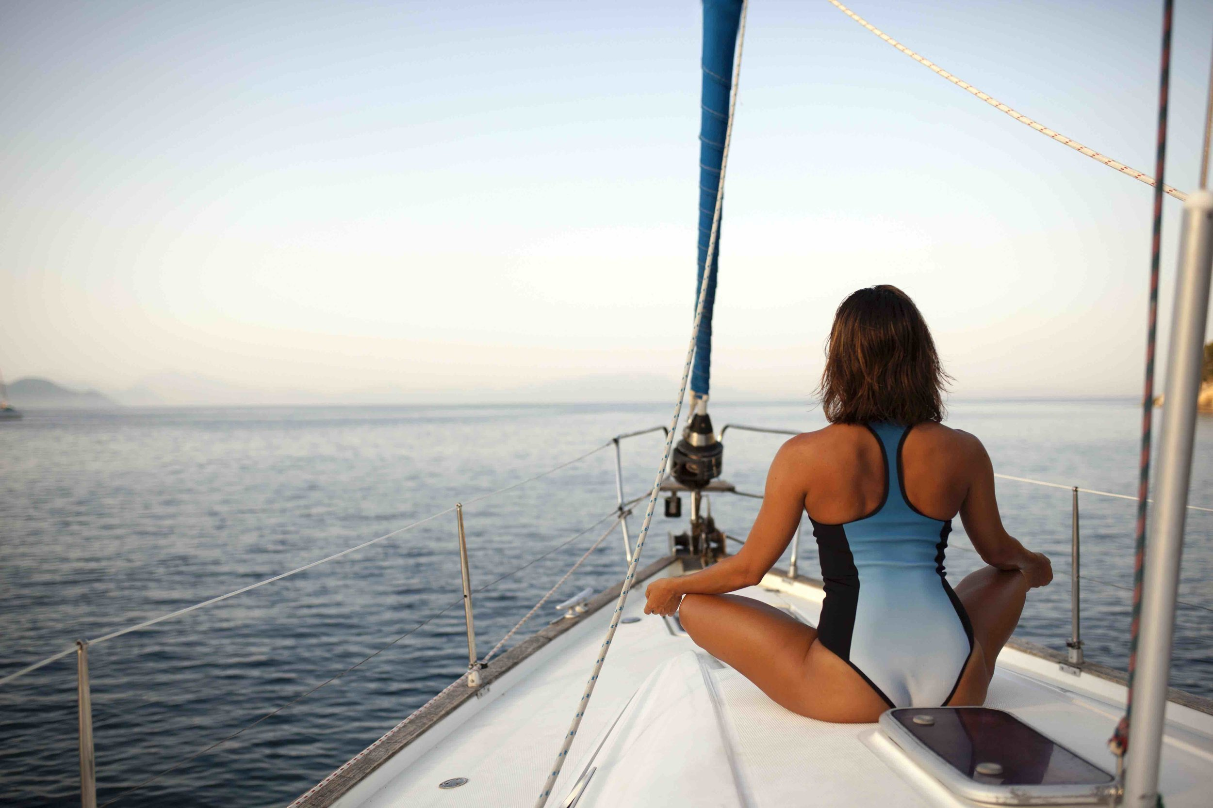 woman contemplating on sailboat.jpg