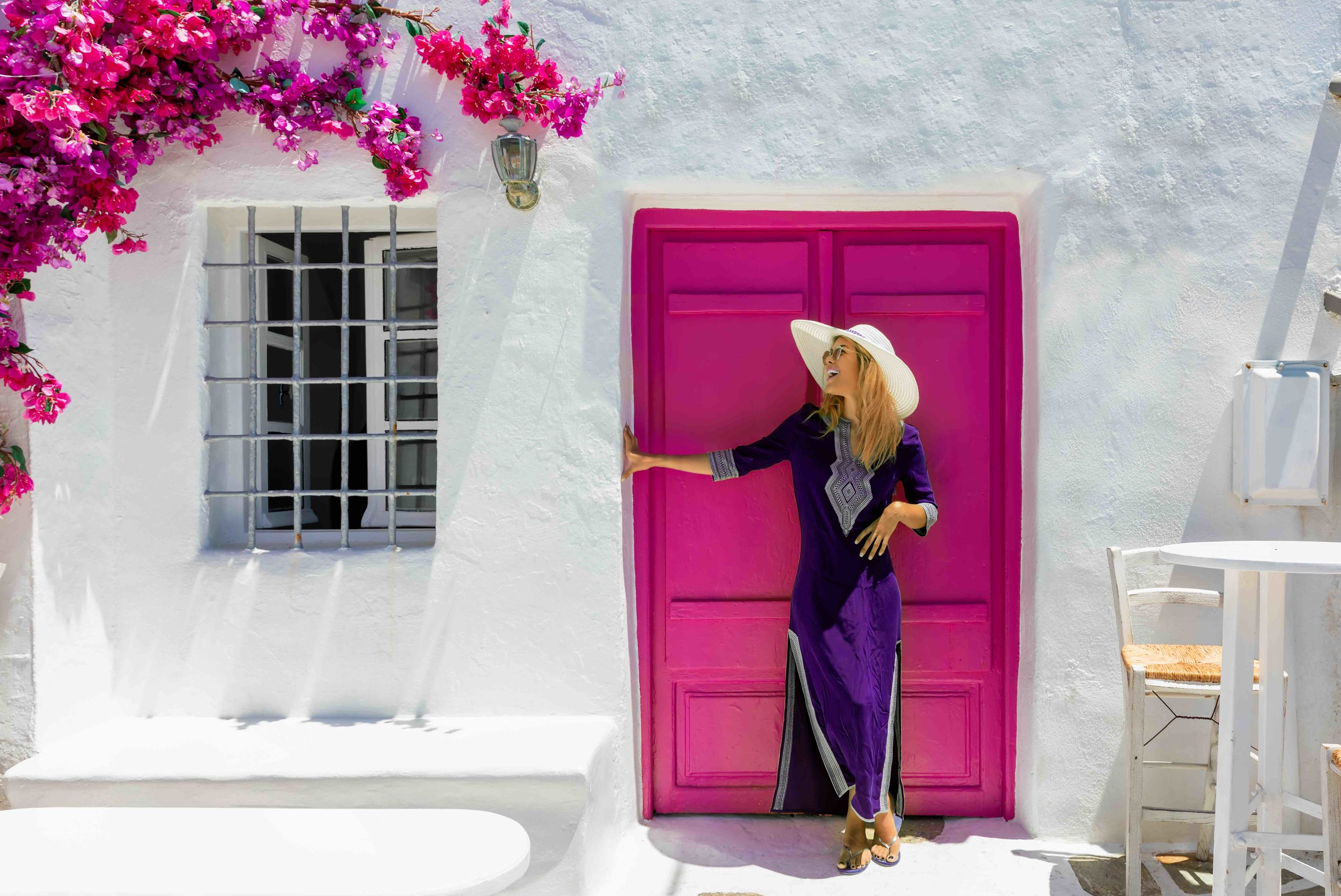 Women with Pink Door Greece.jpg