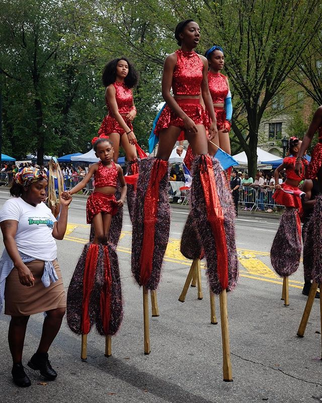 West Indian American Day Parade in Brooklyn. When the DJ 16-wheel trucks roll through its an absolute wall of base that makes your body shudder. I was looking for those moments in between. These girls learned to walk on stilts at their school, carrying the legend of the Moko Jumbie, a legendary healer in Trinidad 🇹🇹 via West Africa who is said to have watched over the tribes, protecting them from evil. #trinidad #brooklyn #westindiandayparade #fujixe2s