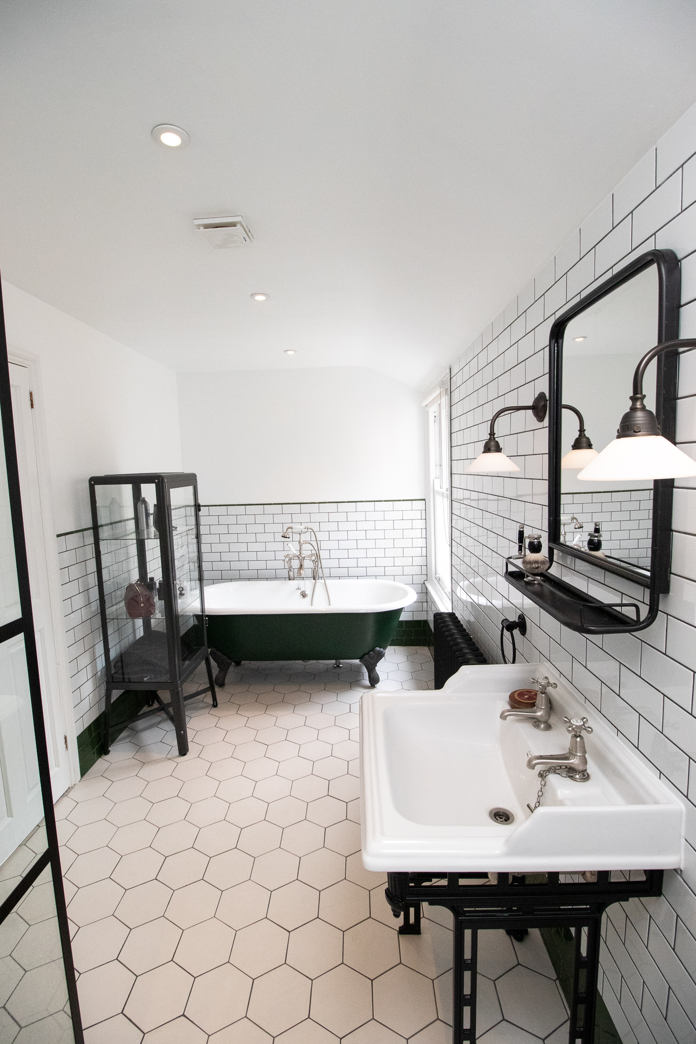 SUBWAY TILE, METRO TILE, WHITE BATHROOM, BLACK IRON, CLAW FOOT BATH TUB.jpg