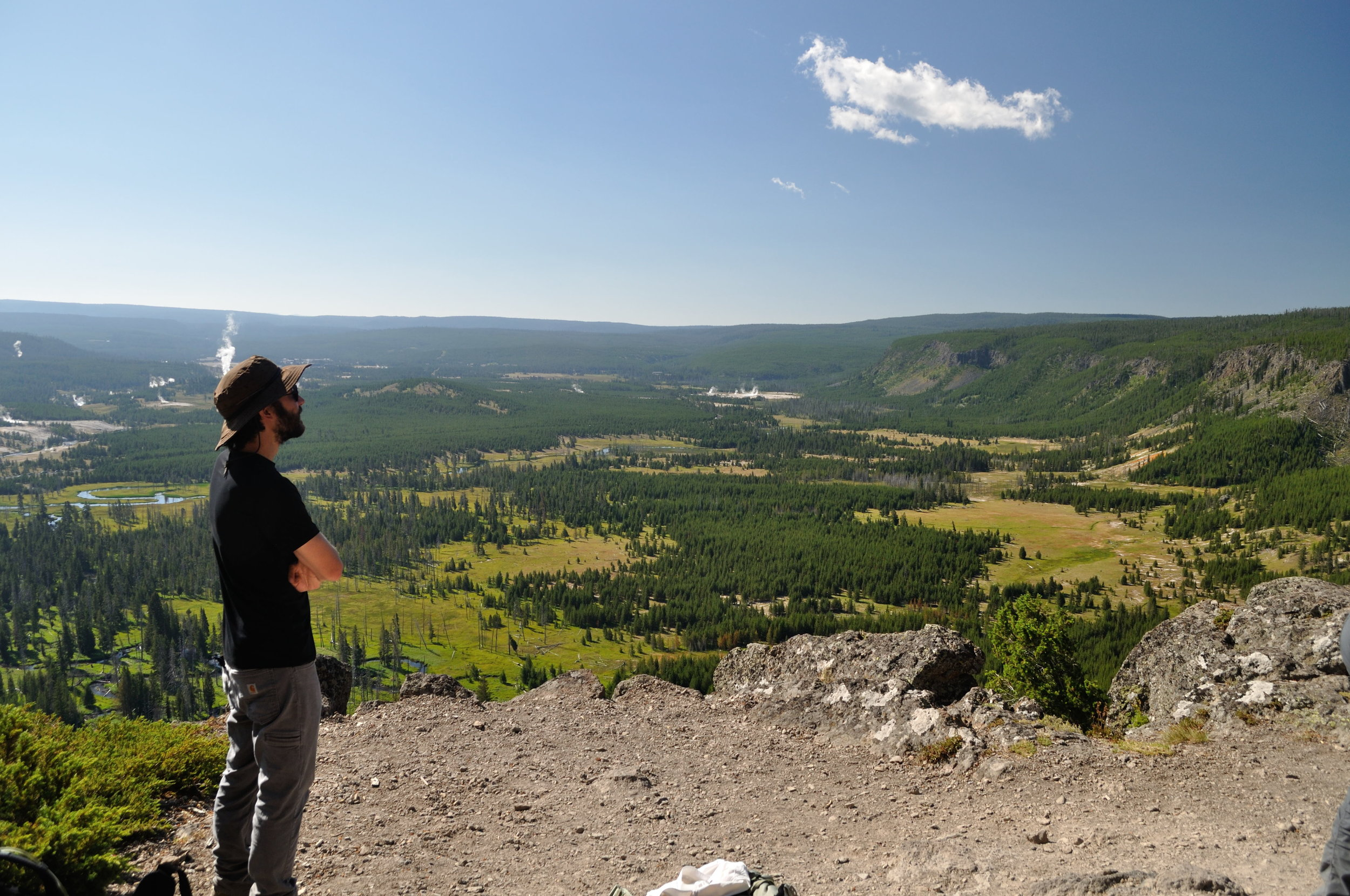 Graduate student Elijah Lee looking out over one of his study areas in Yellowstone National Park