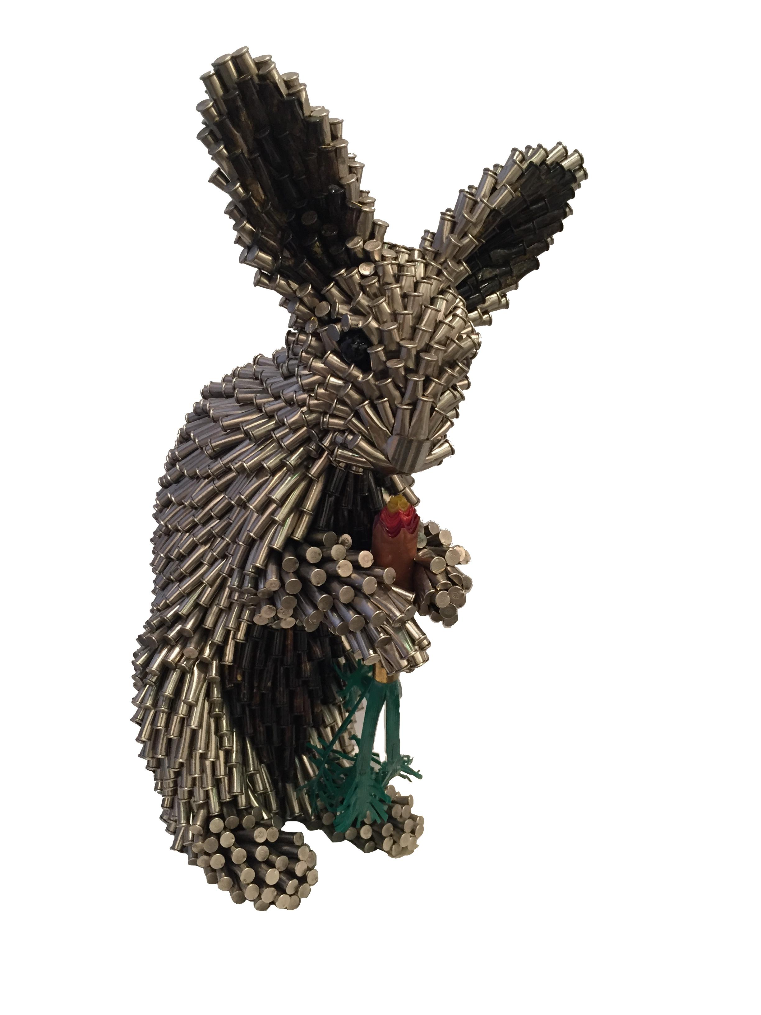 Silver Rabbit with Carrot,  2018 Bullet shells 15 x 9 x 8 inches