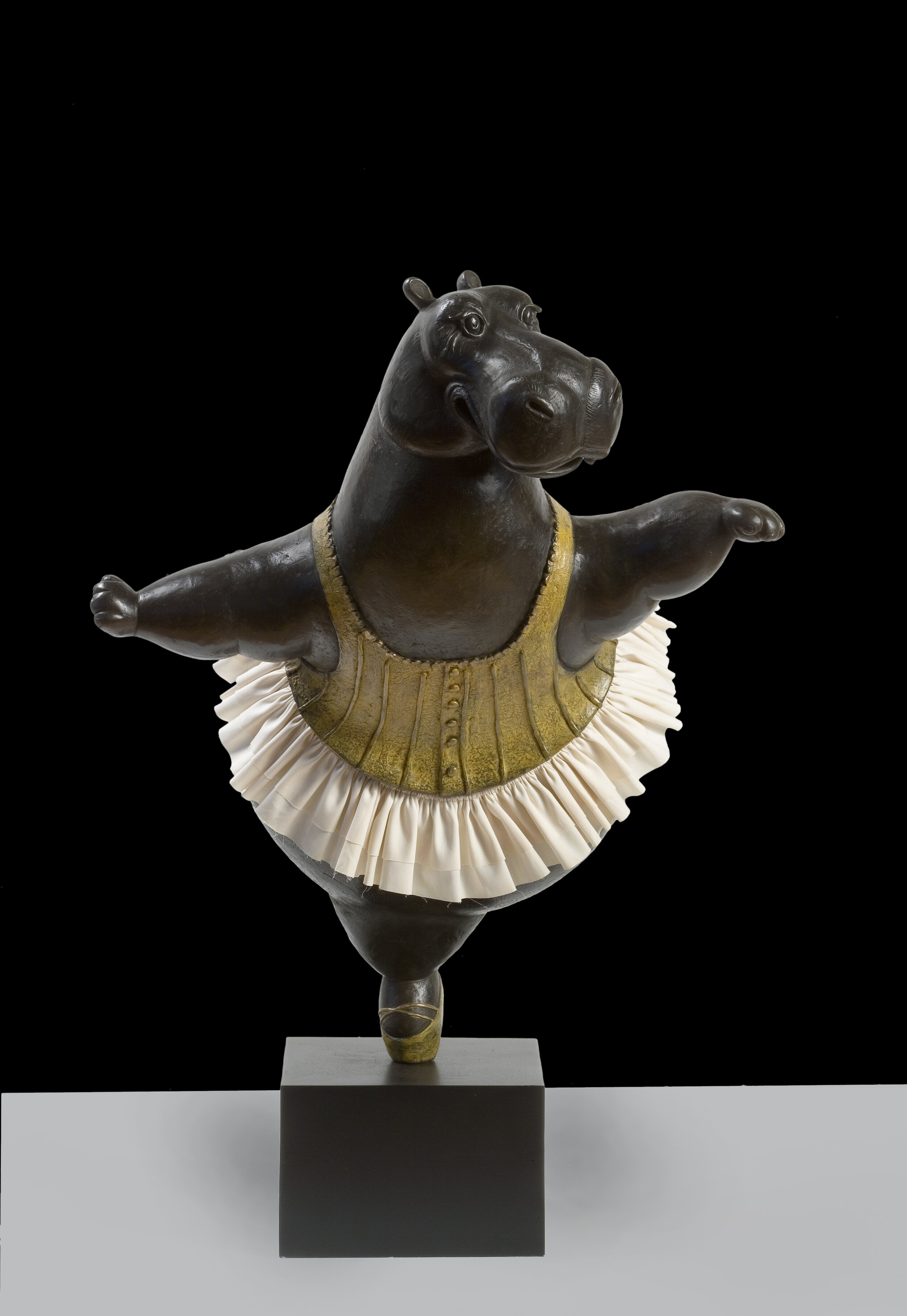 Hippo Ballerina, Pirouette, ed. 1/9 , 2019,  Bronze with fabric skirt  23 1/2 x 20 x 16 inches   Also available in maquette size:    Hippo Ballerina, Pirouette, ed. 1/9 , 2019 Bronze with fabric skirt 12 x 10 x 8 inches