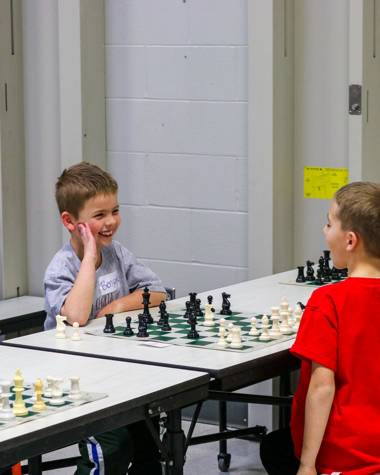 "TEstimonials - ""My kids really enjoy playing Chess!""""James had a blast and picked a special place on his bookshelf for his trophy""""Our boys love their Friday afternoons playing chess"""