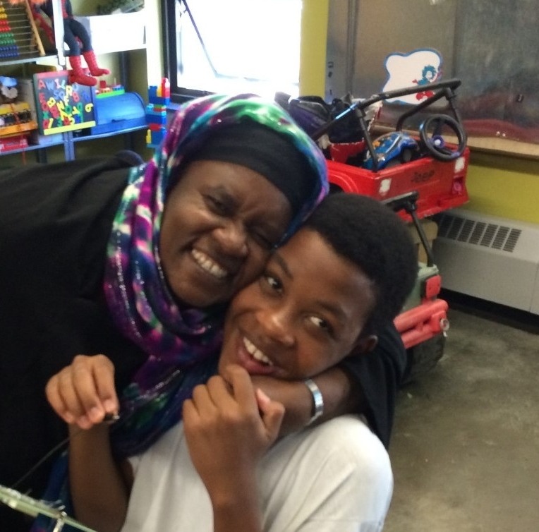 """Zahra - """"Mama Zahra,"""" a long-time Yesler Terrace resident, is well-known in the community. Originally a refugee from Somalia, Zahra has made Seattle her home and brings her three children to BBSC regularly."""