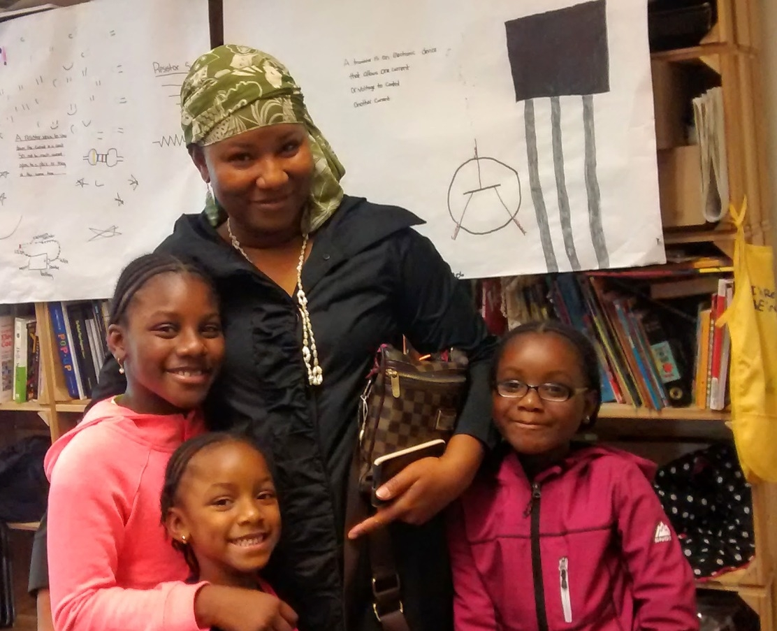 Rachida - Rachida is the mother of three young Big-Brained Superheroes who joined the BBSC after moving to Yesler Terrace from Togo, West Africa. What does she love about Seattle? The water.