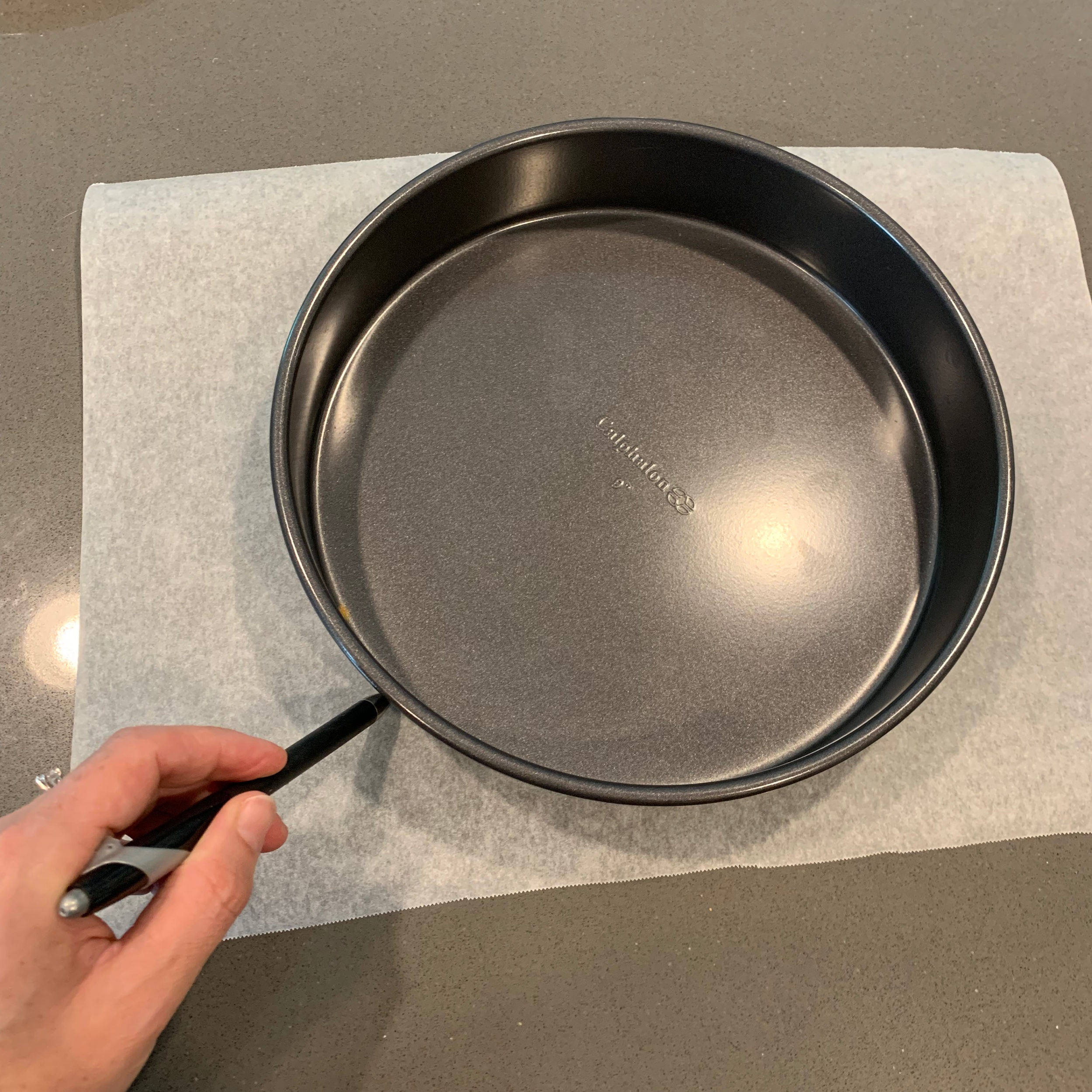 Trace your pan then cut out the template to fit snuggly inside the pan