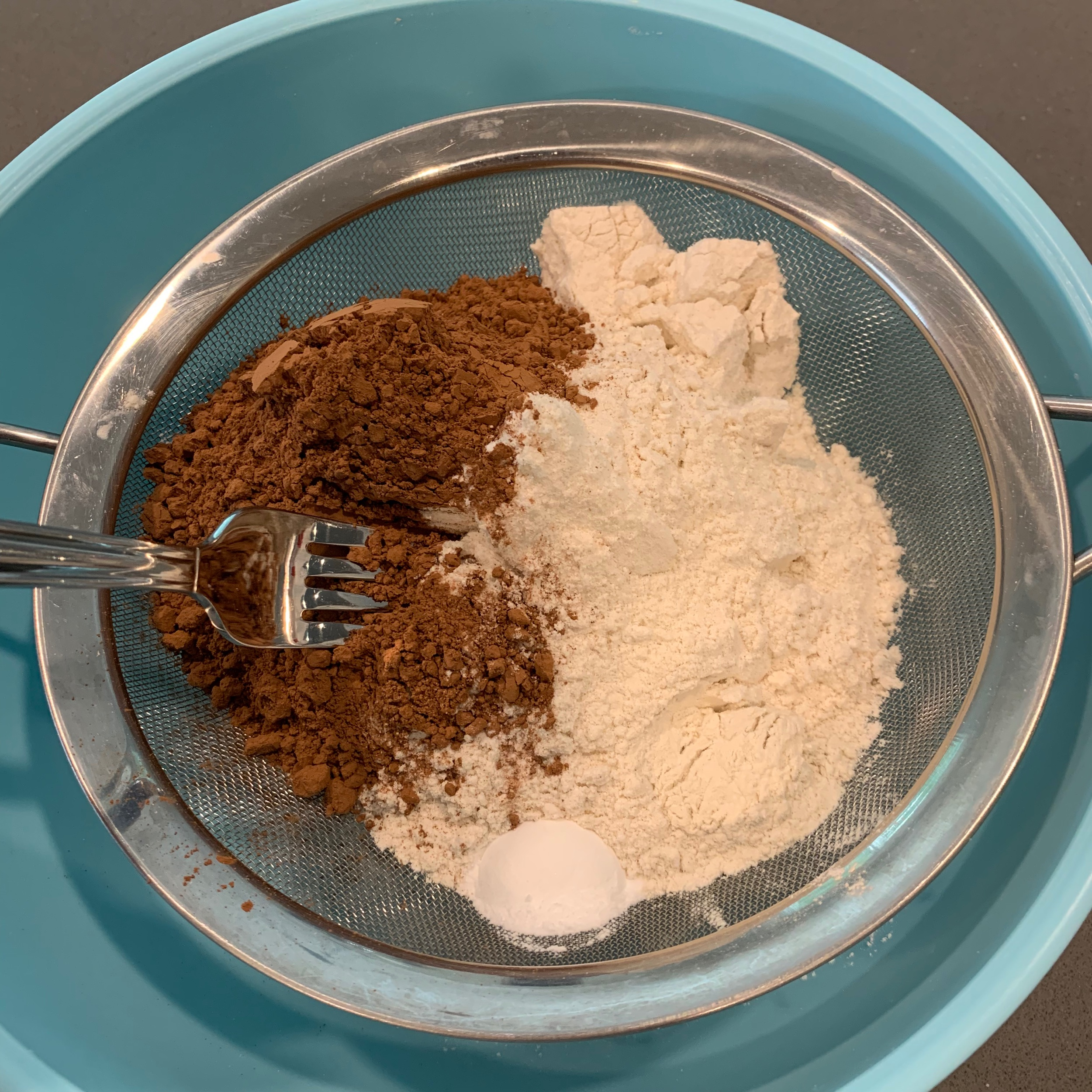 Sift the flour ingredients into a large bowl using a fork