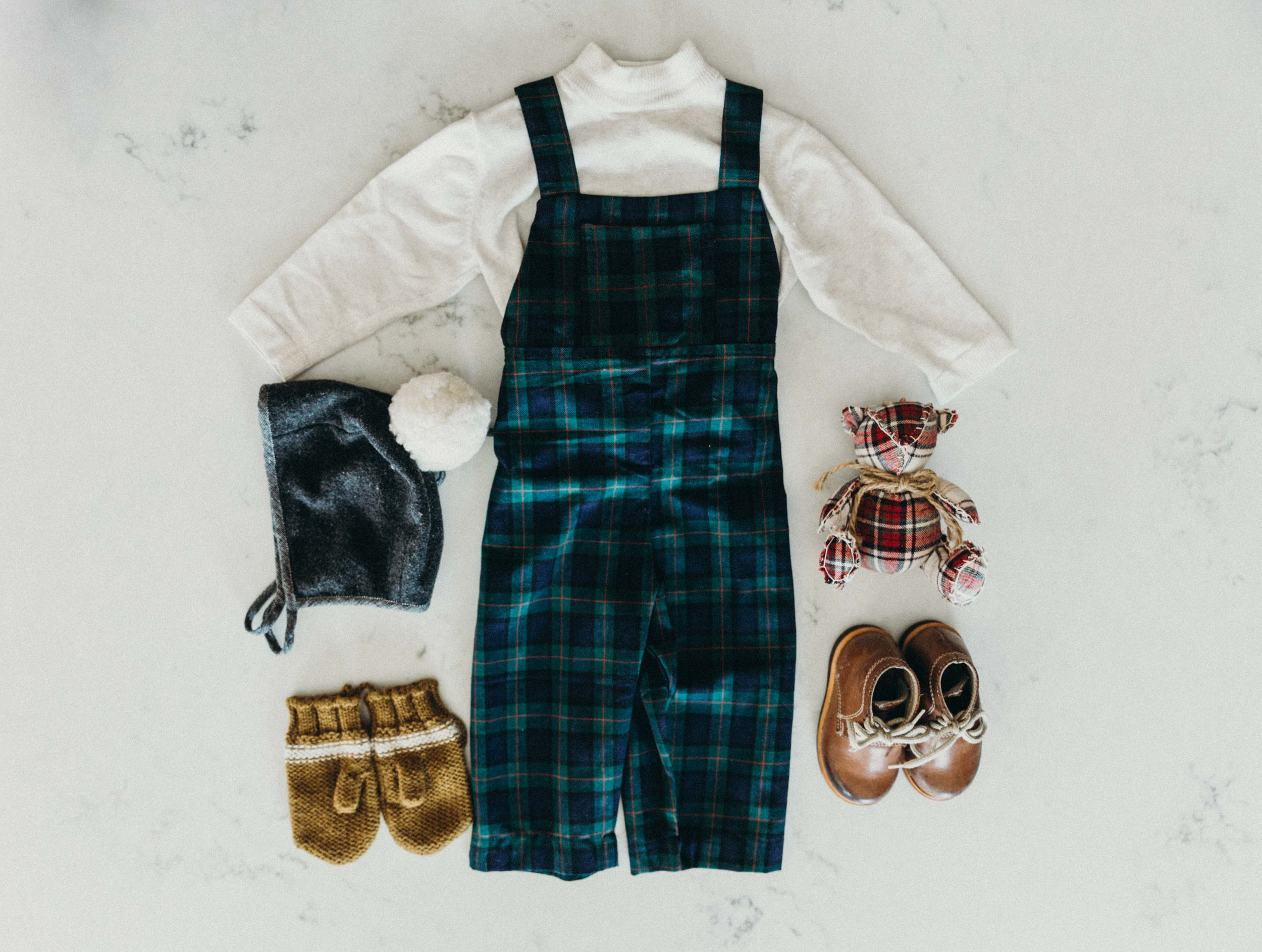 James' Christmas Eve outfit: mittens by Fin & Vince in honeycomb, pom bonnet by Briar Handmade, overalls by Fin & Vince, milo boots By The Humble Soles (use code cathlins10 for 10% off your Humble soles order)