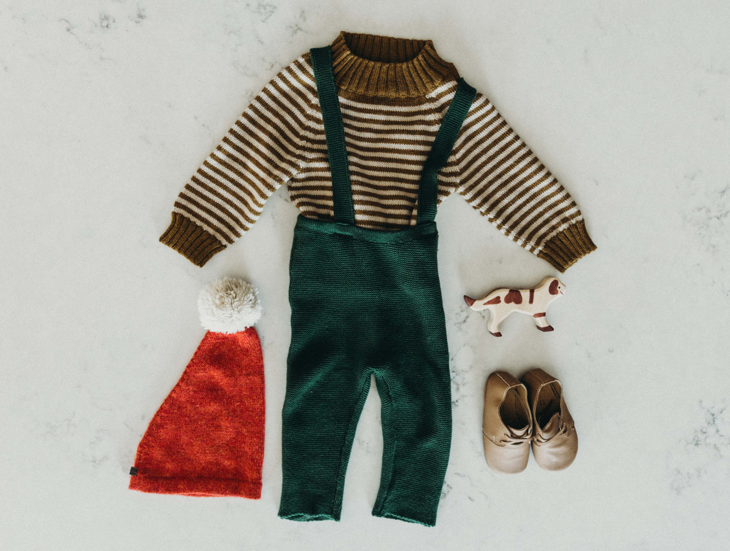 Ayrton's Christmas Eve duds: OeufNYC Santa hat, Fin & Vince honey stripe alpaca sweater, Fin & Vince pine suspender pants, The Humble Soles Rama soft sole shoe (note: you can use code CATHLINS10 for 10% off at The Humble Soles)