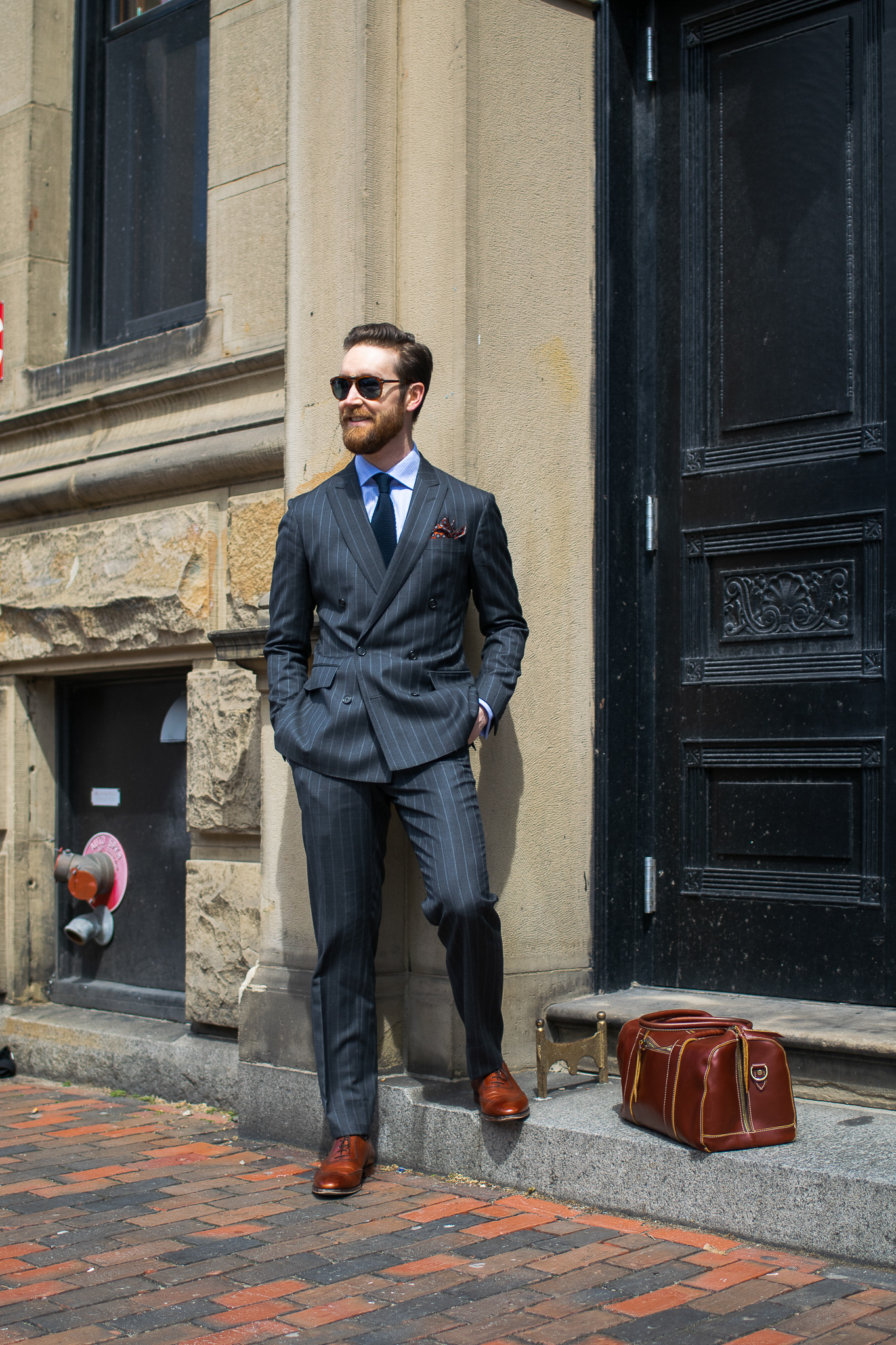 The Pinstripe Double-Breasted Suit  Suit by Brooks Brothers / Shoes by Brooks Brothers / Tie by Brooks Brothers / Shirt by Brooks Brothers / Pocket square by Brooks Brothers / Bag by Brooks Brothers / Sunglasses by Brooks Brothers