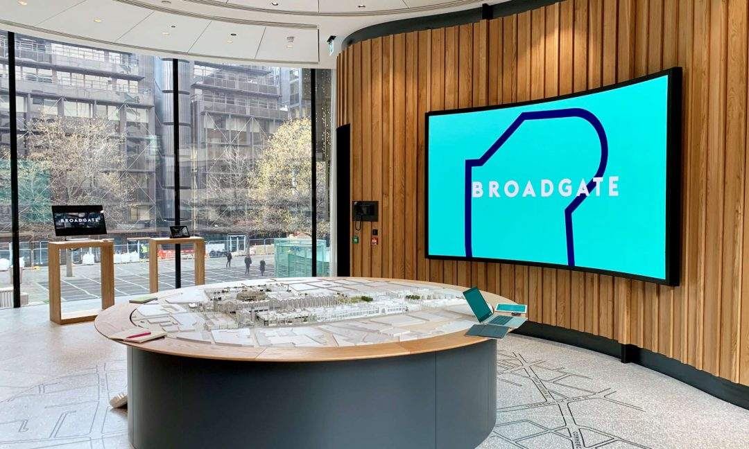 CASE STUDY -3 BROADGATE - Rather than being suspended from the ceiling, a custom bracket and frame was developed to give the impression of a flying display in front of the curved wall. The bracket included a swing mechanism to allow easy access for maintenance and installation and has magnetic locks to lock the screen into place, with the ability to be activated and deactivated by the control systems engineering functions. Entirely bespoke, the bracket and frame are designed by IVC Technologies Ltd in partnership with AVS Metalwork Innovations.
