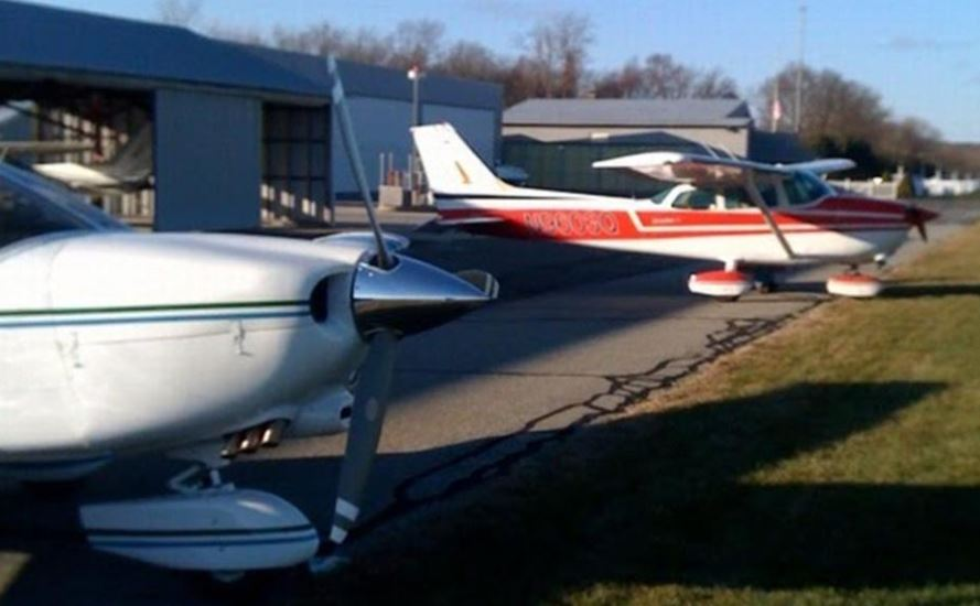 Both Planes outside hangers at Chester Airport - SNC