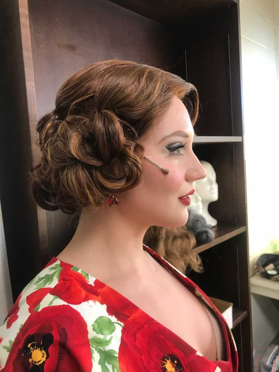This wig was dyed and styled to fit the red color that the director and costume designer wanted.