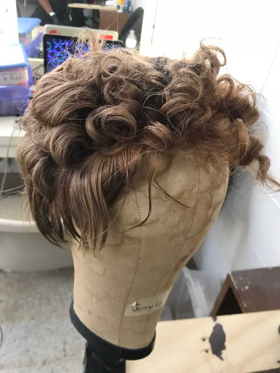 This styled look needed to stay curly, move with the actor, but still look realistic.