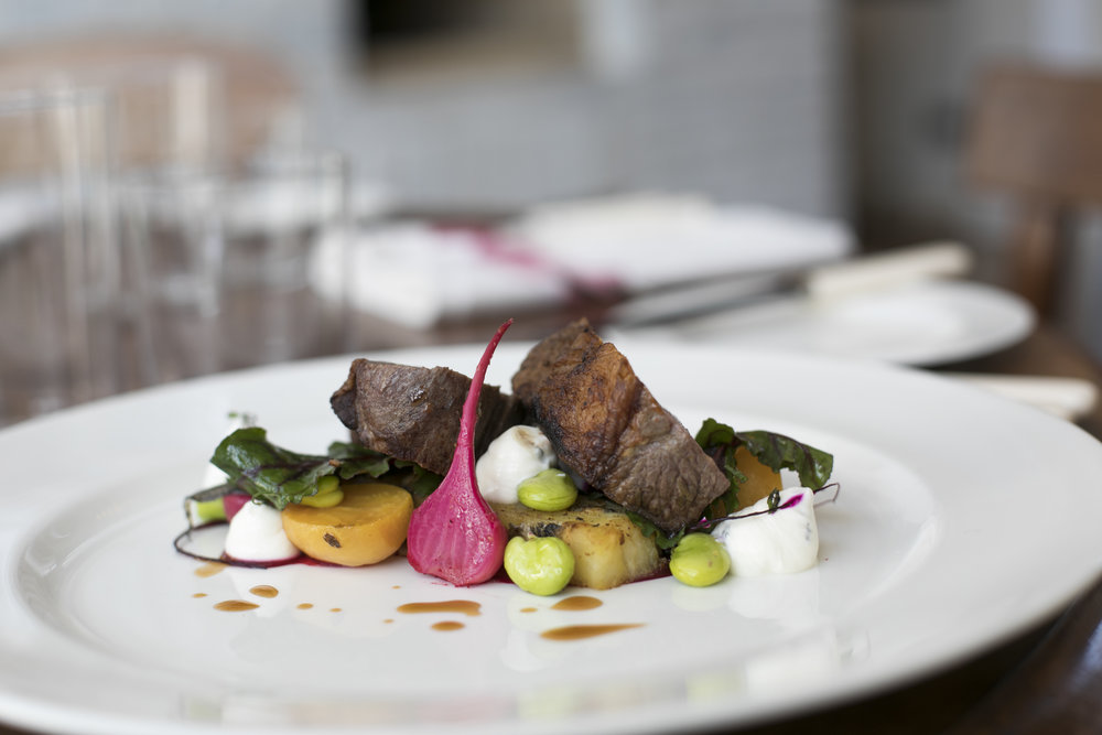 Spiced Haunch of Lamb with anchovies, broad beans, baby beets and smoked bacon.