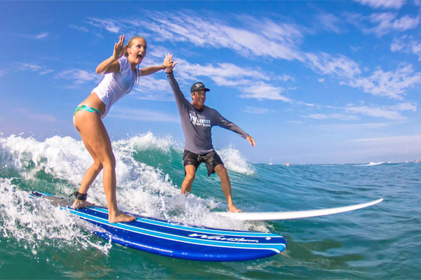 Ty-Gurney-Surf-School-Surf-Lessons-Private-Joey-High-Five.jpg