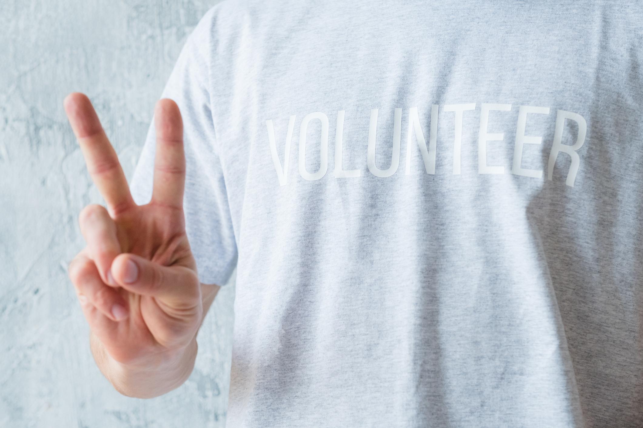 volunteering-modern-lifestyle-man-show-v-sign-1129785844_2125x1416.jpeg