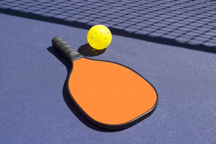 Pickleball---Orange-Paddle-Yellow-Ball-Net-Shadow-513726615_2121x1416.jpeg