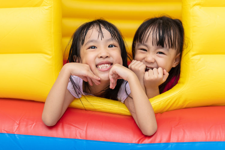 Asian-Little-Chinese-sisters-playing-at-inflatable-castle-1001369956_1258x839.jpeg
