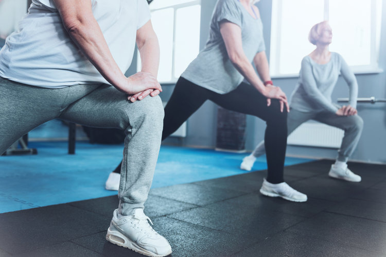 Close-up-look-on-retired-women-lunging-at-fitness-club-936573360_1256x838.jpeg