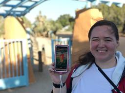 Rebecca Warner shows Pokémon Go on her phone screen.