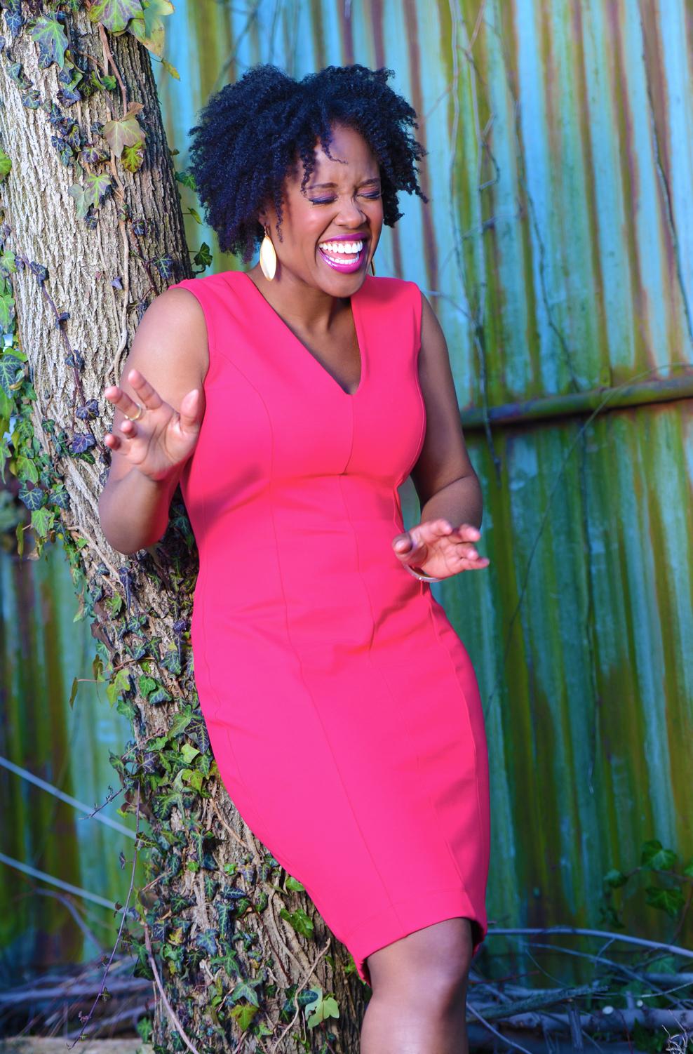Akilah Green Laughing in Pink Dress