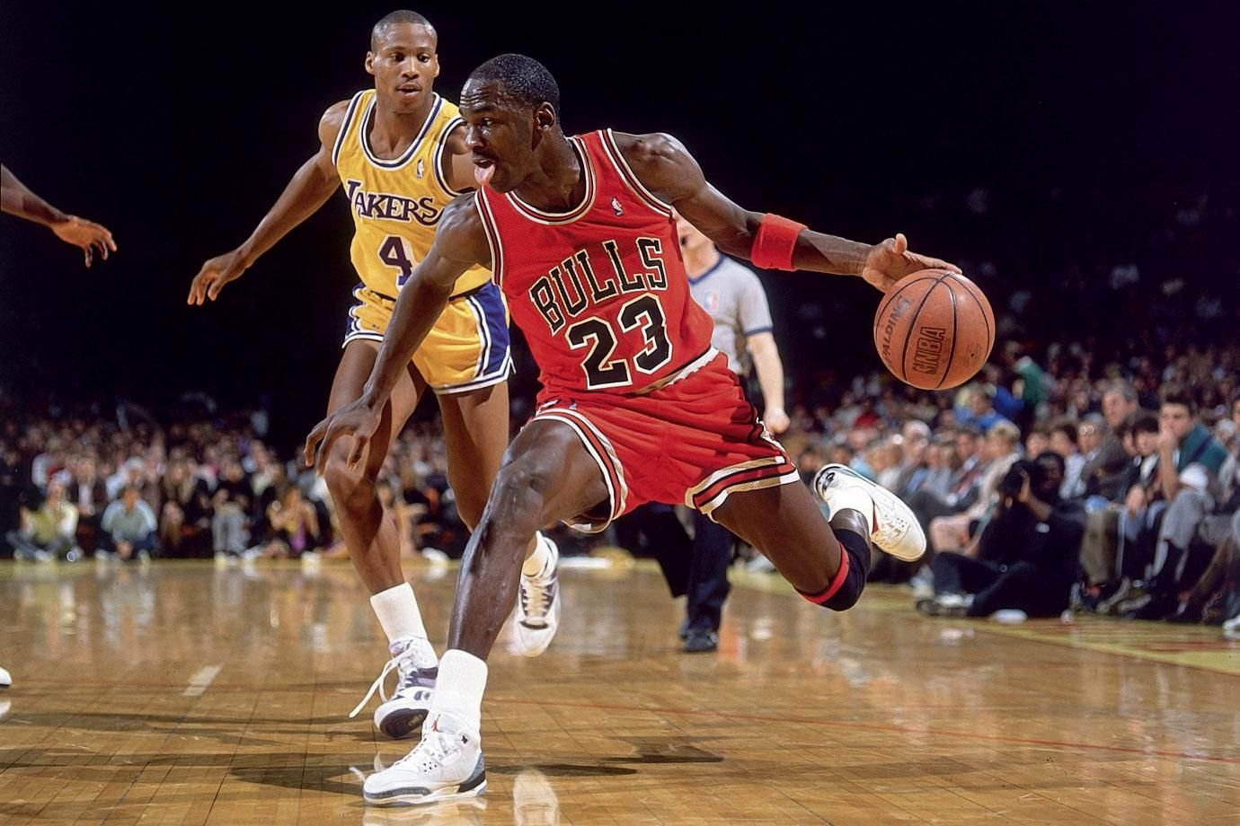 Michael Jordan fakes on a drive against the Los Angeles Lakers in February 1988. By Andy Hayt for Sports Illustrated