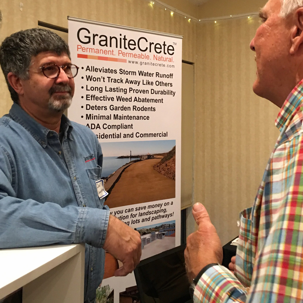 David Ventura, of GraniteCrete, with representative from Sierra Azul Nursery.