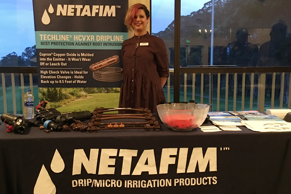 Katia Velasquez from Netafim showing their Techline HCVXR Dripline. Katia is also Central Coast's Events Director.