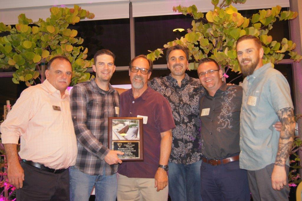 The K & D Landscaping team picks up the Landscape Sweepstakes Award