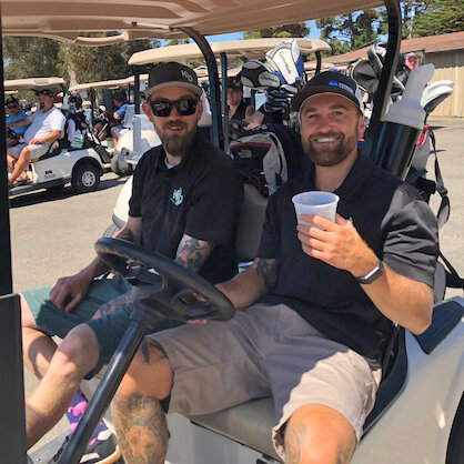 K&D enjoying the game, President of Central Coast Chapter, Justin White on the right