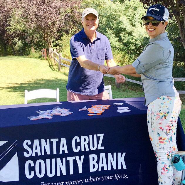 New sponsor - Santa Cruz County Bank's VP Brent Denton with Netafim's Katia Velasquez, Central Coast Events Director