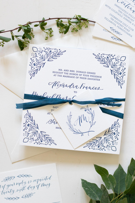 Simple monogram tag wrapped wedding invitation