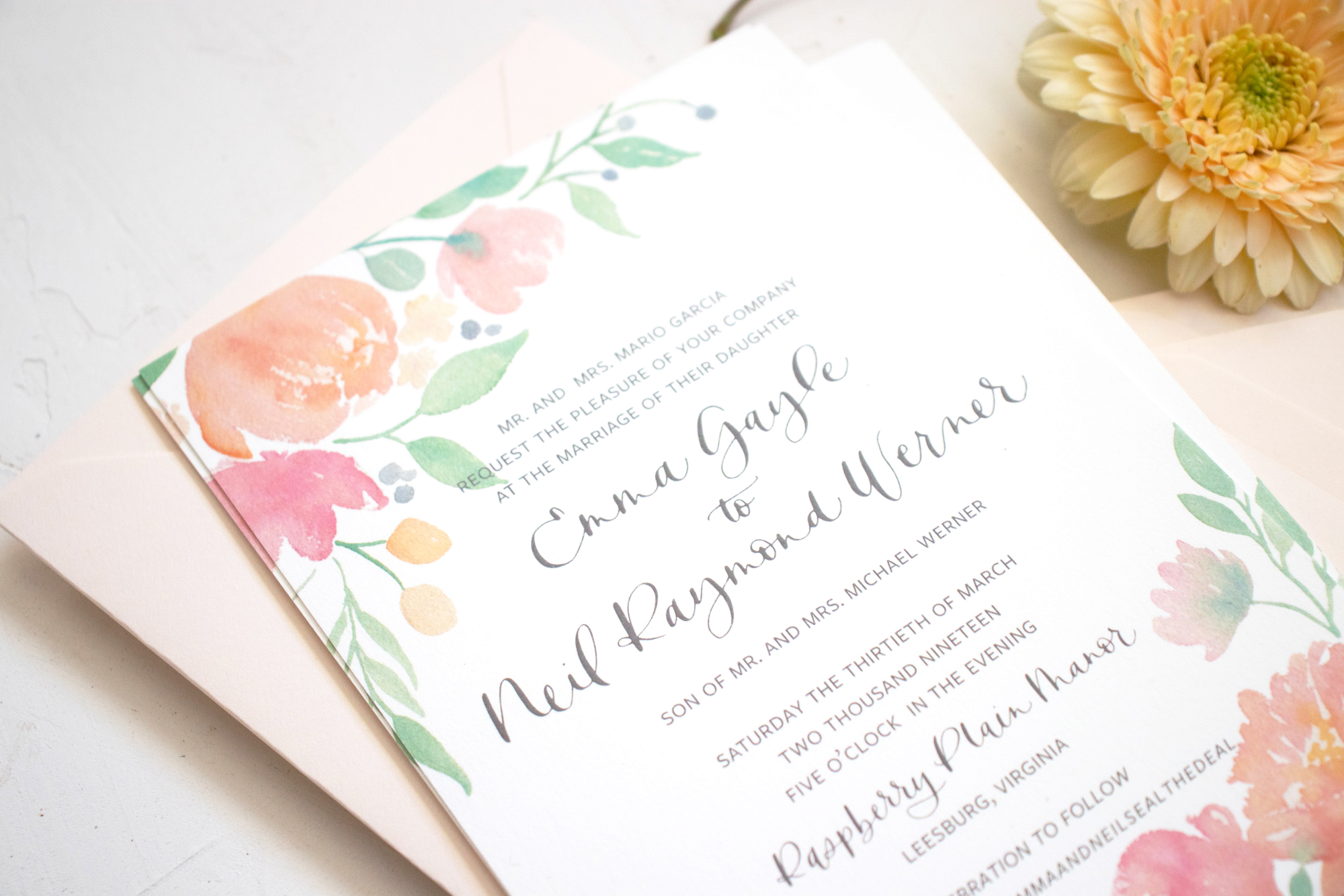 Watercolor floral wedding invitation in shades of coral and pink