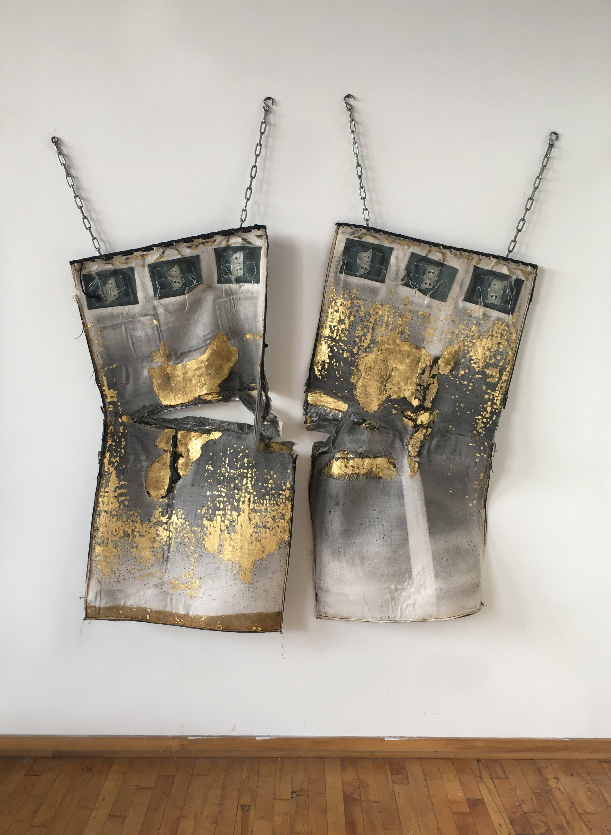 Cheryl Pope     Heavyweight (2017)     23k gold leaf, steel chains, used leathery Heavy boxing bag, duct tape    Sold.