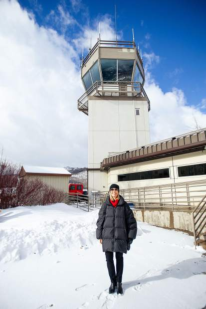 Suzanne Pfister in front of Aspen's airport traffic control tower.