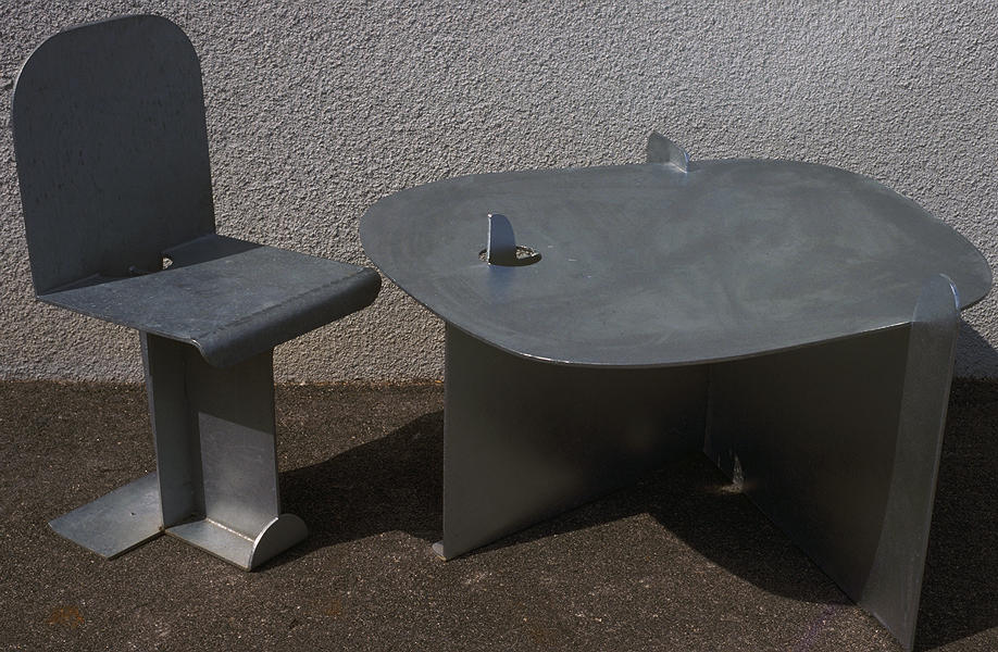 Isamu Noguchi  Table and Chair  Pierced Table 1983  Galvanized steel  22 x 37 x 37 inches      View More Isamu Noguchi