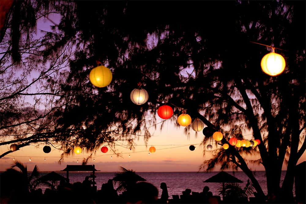 The Friday night beach party at the Caribbean Village's Treasure Beach is a great place to watch the sunset over Grace Bay. Hanging paper lanterns make for a romantic scene.