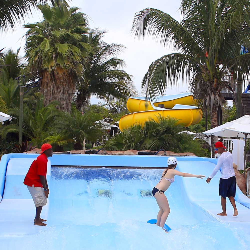 The surf simulator is like a wavy, rubberized pool with a wave machine built into its top.