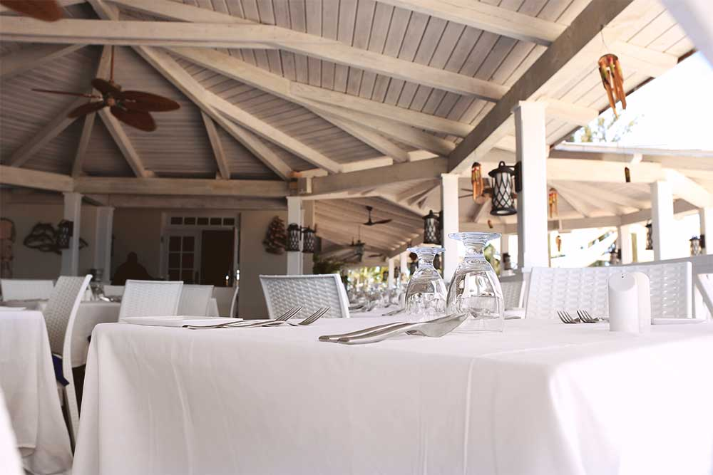 Schooners has a roof, but no walls. The white tables and old-fashioned ceiling fans give the restaurant a relaxed Caribbean vibe. Many of the weddings we've seen at Beaches had the reception here.
