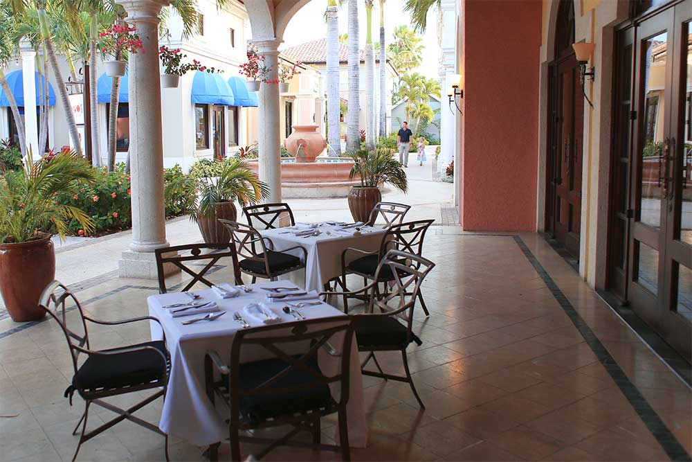 The tables behind Mario's restaurant are quiet and secluded: a great place to have a relaxing meal.